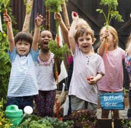 happy children raising their hands